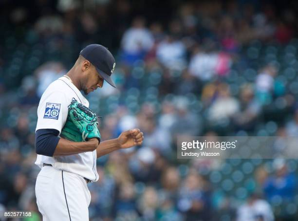 Ariel Miranda of the Seattle Mariners reacts after giving up a three run home run in the ninth inning to Yan Gomes of the Cleveland Indians at Safeco...