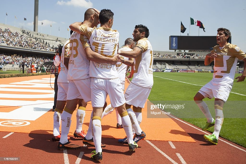 Ariel Nahuelpan of Pumas celebrates after scoring with teammates during a match between Pumas and Leon as part of the Apertura 2013 Liga MX at Olympic stadium, on August 18, 2013 in Mexico City, Mexico.