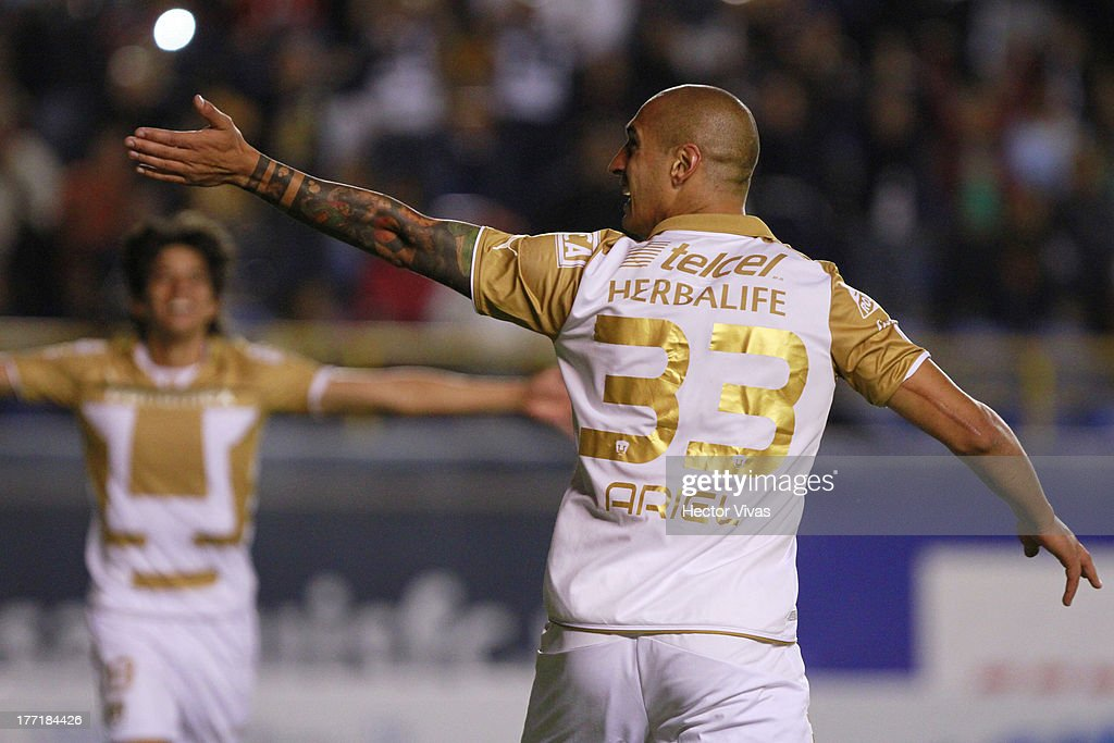 Ariel Nahuelpan of Pumas celebrates during a match between San Luis and Pumas as part of the Apertura 2013 Copa MX at Alfonso Lastras Stadium on...