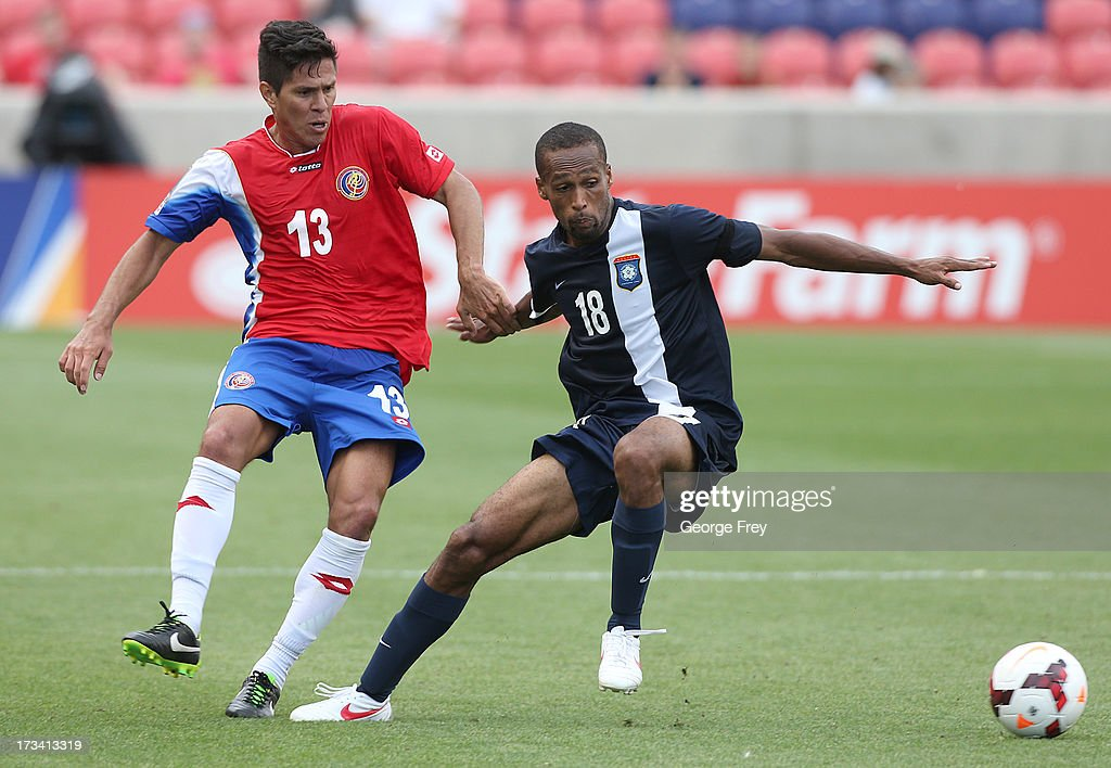 Ariel Rodriguez #13 of Costa Rica and Evral Trapp #18 of Belize battle for the ball during the second half of a CONCACAF Gold Cup match July 13, 2013 at Rio Tinto Stadium in Sandy, Utah. Costa Rica defeated Belize 1-0.