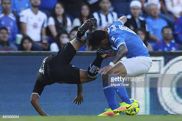 Ariel Rojas of Cruz Azul fights for the ball with Carlos S‡nchez of Monterrey during a match between Cruz Azul and Monterrey as part of the Clausura...