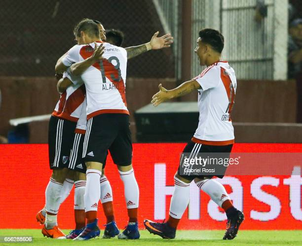Ariel Rojas of River Plate celebrates with teammates after scoring the first goal of his team during a match between Lanus and River Plate as part of...
