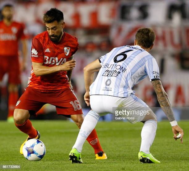 Ariel Rojas of River Plate fights for the ball with Franco Sbuttoni of Atletico de Tucuman during a match between River Plate and Atletico de Tucuman...
