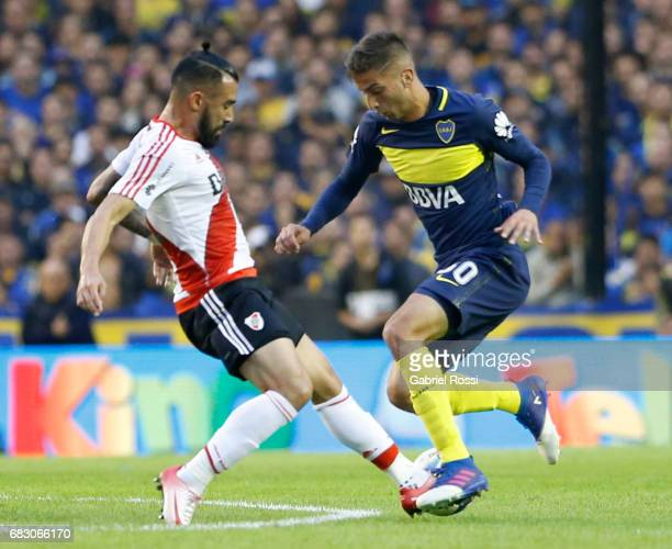 Ariel Rojas of River Plate fights for the ball with Rodrigo Bentancur of Boca Juniors during a match between Boca Juniors and River Plate as part of...