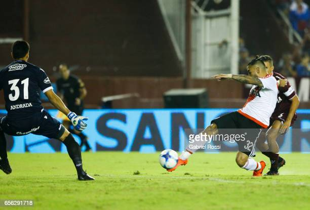 Ariel Rojas of River Plate kicks the ball to score the first goal of his team during a match between Lanus and River Plate as part of Torneo Primera...