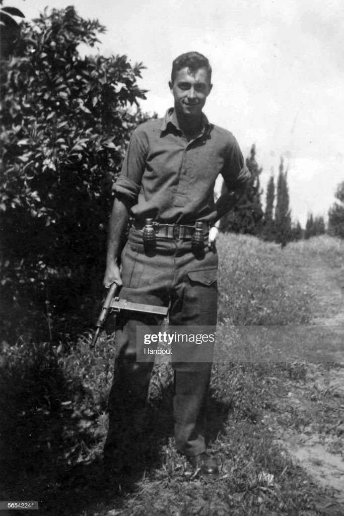 Ariel Sharon holds a Sten gun as a young commander in the Alexandroni Brigade of the fledging Israeli army during the War of Independence in 1948