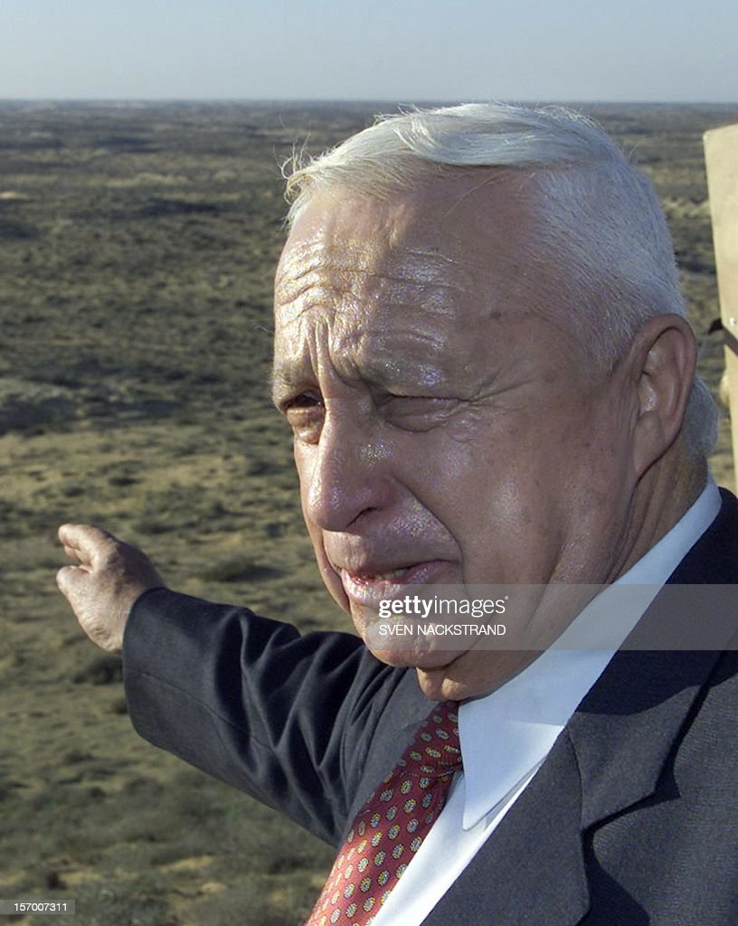<a gi-track='captionPersonalityLinkClicked' href=/galleries/search?phrase=Ariel+Sharon&family=editorial&specificpeople=156426 ng-click='$event.stopPropagation()'>Ariel Sharon</a>, the rightwing Likud's candidate for the prime minister's post, points to the Halutza area during a tour near Moshav Kemhin in the Negev Desert 15 January 2001. Sharon said during the visit, that the sand dunes of Halutza, that Prime Minister Ehud Barak has offered to the Palestinians as a substitute for areas in the West Bank, will never be given away as they are needed for the growth of Israel's Jewish population. Sharon is the frontrunner in the 06 February prime ministerial elections. AFP PHOTO/Sven NACKSTRAND