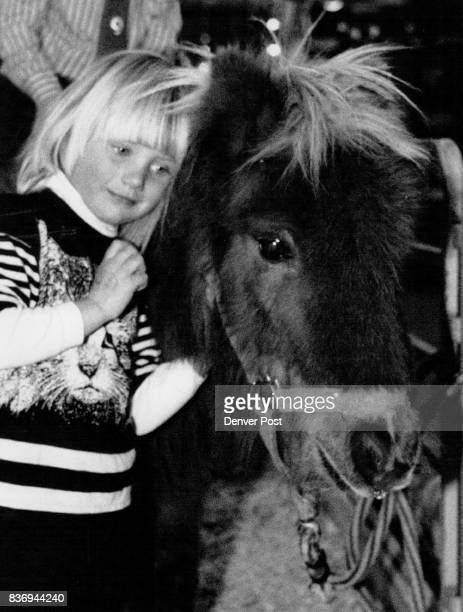 Ariel Wheeler of Boulder snuggles up against a Shetland pony in Ranchland in the Hall of Education at the National Western Stock Show Credit The...
