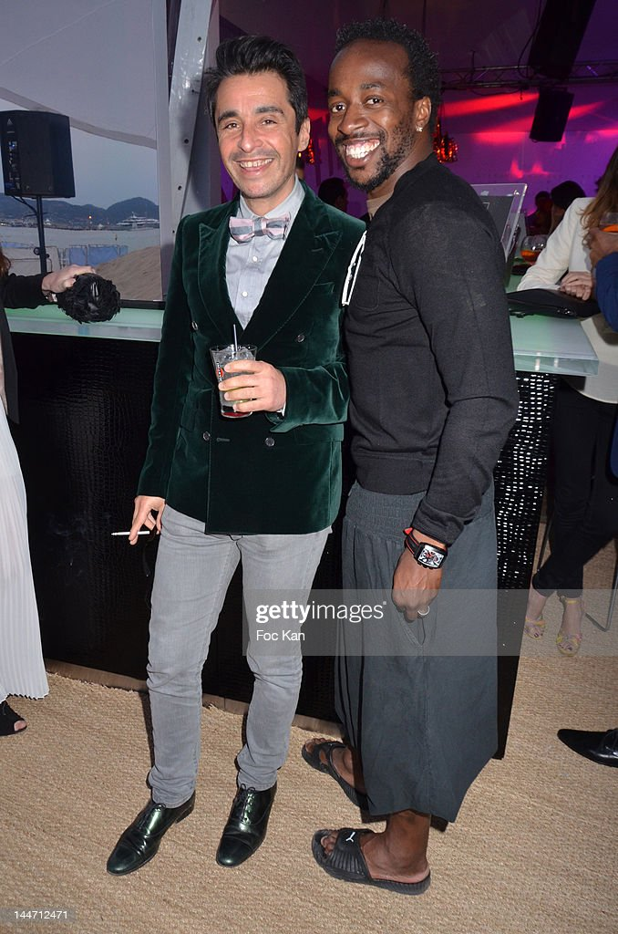 DJ Ariel Wizmann and footballer <a gi-track='captionPersonalityLinkClicked' href=/galleries/search?phrase=Sidney+Govou&family=editorial&specificpeople=242983 ng-click='$event.stopPropagation()'>Sidney Govou</a> attend the Frederic Beigbeder DJ Set at Martini Terrace - 65th Annual Cannes Film Festival on May 17, 2012 in Cannes, France.