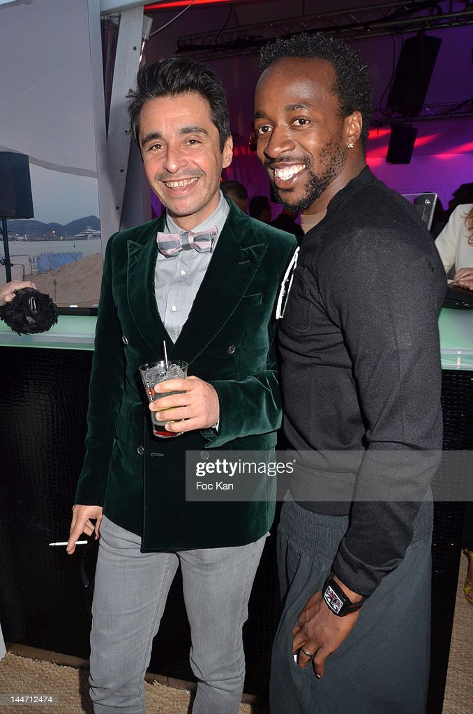 DJ Ariel Wizmann and footballer Sidney Govou attend the Frederic Beigbeder DJ Set at Martini Terrace - 65th Annual Cannes Film Festival on May 17, 2012 in Cannes, France.