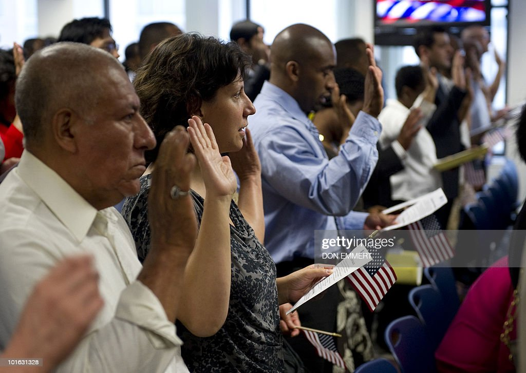 Ariella Peist of Israel takes the oath during a naturalization ceremony June 4, 2010 at the US Citizenship and Immigration Services offices of the Federal Building in New York. Peist became a citizen of the US. More than 150 men and women from 49 countries took the US citizenship oath Friday in lower Manhattan, in a ceremony fraught with emotion and designed to instill admiration and set it apart from other, bureaucratic acts of allegiance. In the midst of a heated national debate on immigration and the growing threat from, at times, even domestic terrorists, becoming an American citizen is a solemn occasion deliberately made so by the US government.