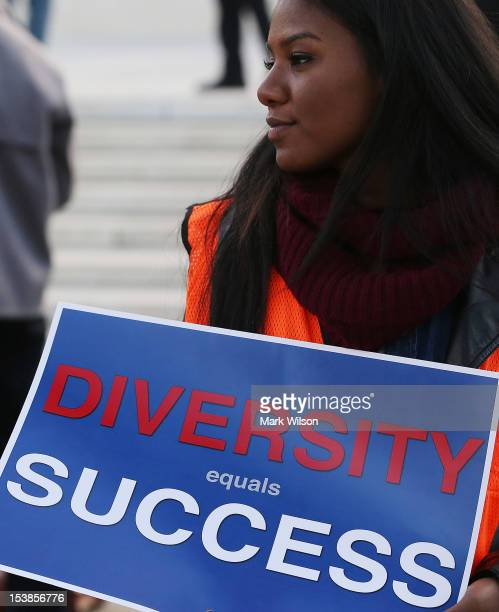 Arielle Atherley holds a sign that reads 'Diversity Equals Success' in front of the US Supreme Court on October 10 2012 in Washington DC Today the...