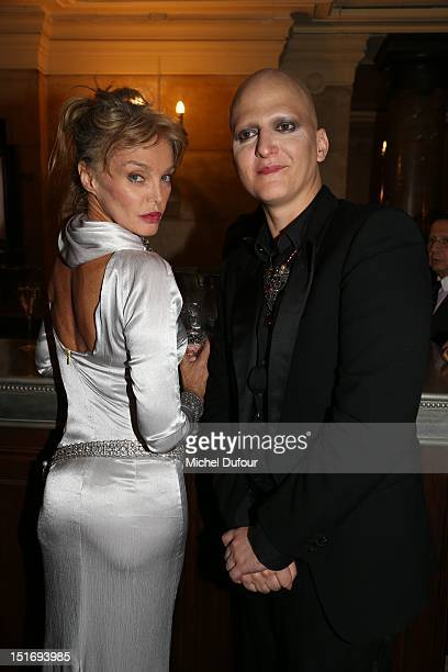 Arielle Dombasle and Ali Madhavi attend the George Michael Performing For Symphonica to the benefit of the French SidactionArrivals at palais garnier...