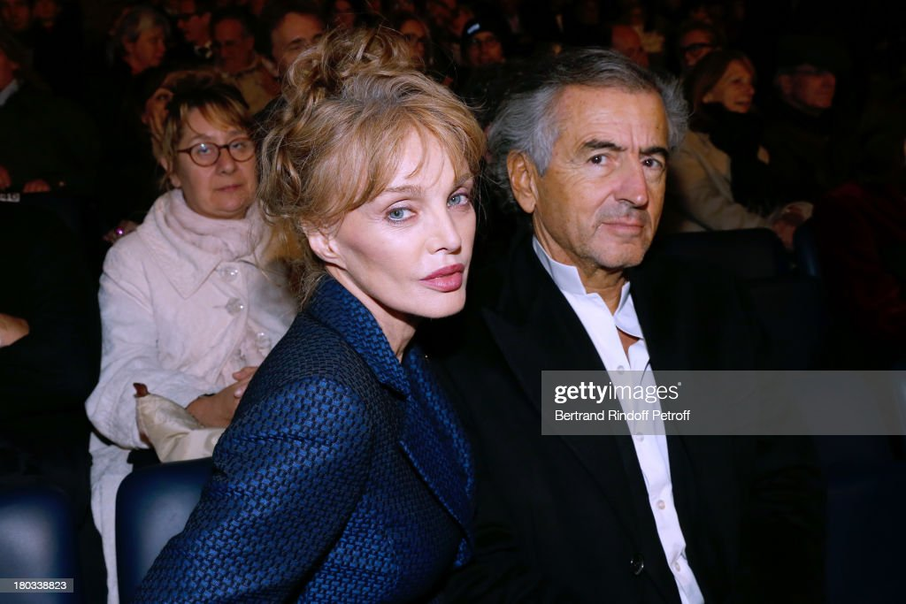 <a gi-track='captionPersonalityLinkClicked' href=/galleries/search?phrase=Arielle+Dombasle&family=editorial&specificpeople=616903 ng-click='$event.stopPropagation()'>Arielle Dombasle</a> and Bernard-Henri Levy attend 'Opera En Plein Air' : Gala with 'La flute enchantee' by Mozart play at Hotel Des Invalides on September 11, 2013 in Paris, France.