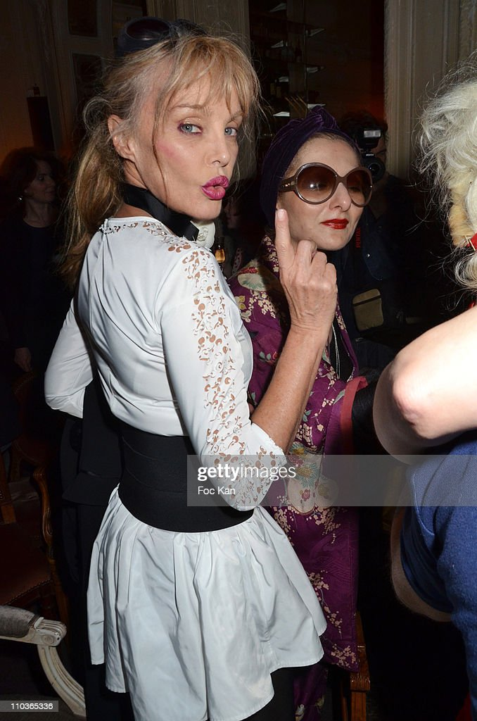 Arielle Dombasle and Catherine Baba (glasses) attend the Philippe Katerine and Fifi Chachnil Concert At the 'Carmen' on March 1, 2011 in Paris, France.