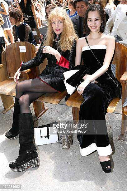 Arielle Dombasle and Kiko Mizuhara attend the Chanel show as part of Paris Fashion Week HauteCouture Fall/Winter 20132014 at Grand Palais on July 2...