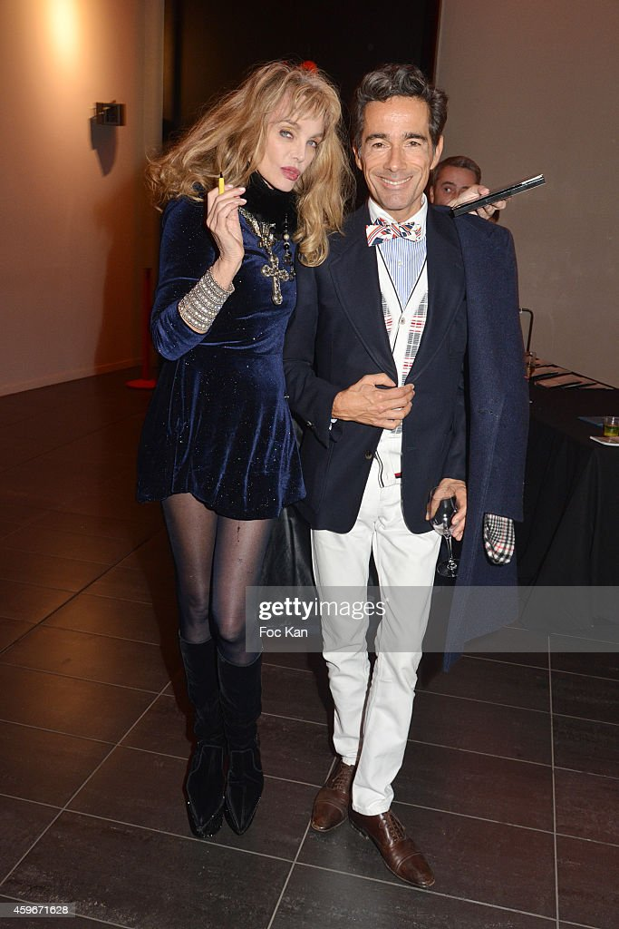 Arielle Dombasle and Vincent Darre attend the 'Soiree Arielle Dombasle' At Cheries Cheris LGBT 20th Festival At MK2 Bibliotheque on November 27