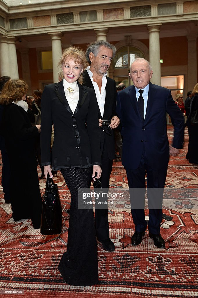 Arielle Dombasle BernardHenri Levy and Francois Pinault attend Rudolf Stingel Exhibition Official Opening at Palazzo Grassi on April 6 2013 in Venice...