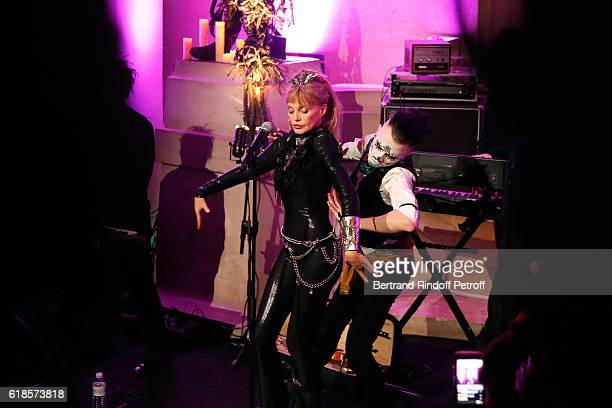 Arielle Dombasle dancing with JeanMich as she performs for the release of the Album 'La Riviere Atlantique' 'Noche de los muertos' event during the...