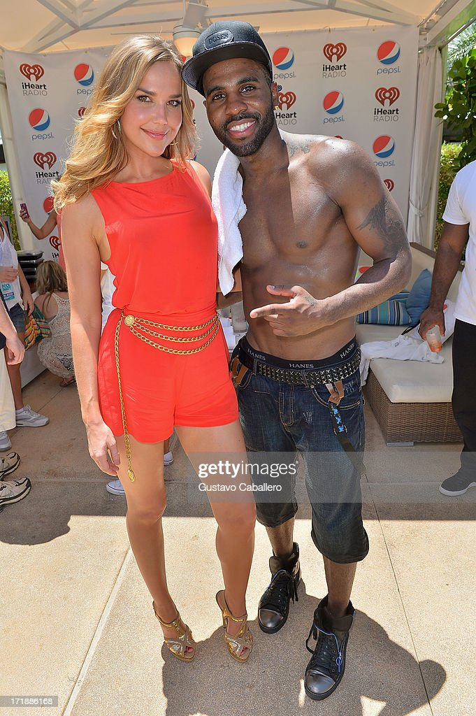 Arielle Kebbel interviews Jason Derulo at the iHeartRadio Ultimate Pool Party Presented by VISIT FLORIDA at Fontainebleau's BleauLive in Miami featuring live performances by Pitbull, Ke$ha, Afrojack, Icona Pop, Krewella and Jason Derulo on June 29, 2013 in Miami Beach, Florida.