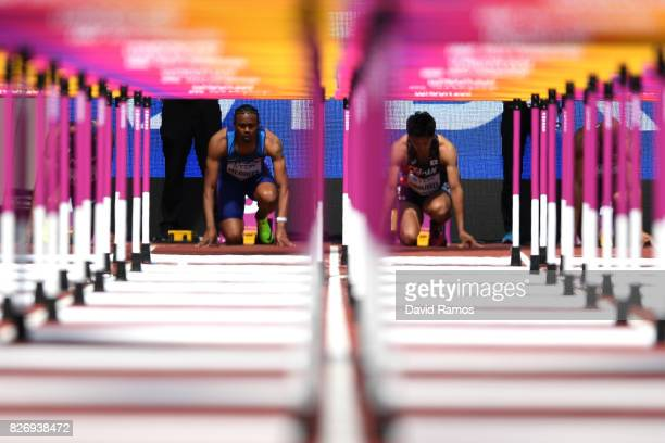 Aries Merritt of the United States and Hideki Omuro of Japan compete in the Men's 110 metres hurdles heats during day three of the 16th IAAF World...