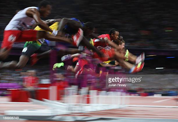 Aries Merritt of the United States leads Jason Richardson of the United States and Hansle Parchment of Jamaica in the Men's 110m Hurdles Final on Day...