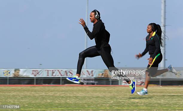 Aries Merritt of the USA Track and Field Team and Natasha Ruddock of Jamaica train on the campus of Texas AM on April 9 2013 in College Station Texas...