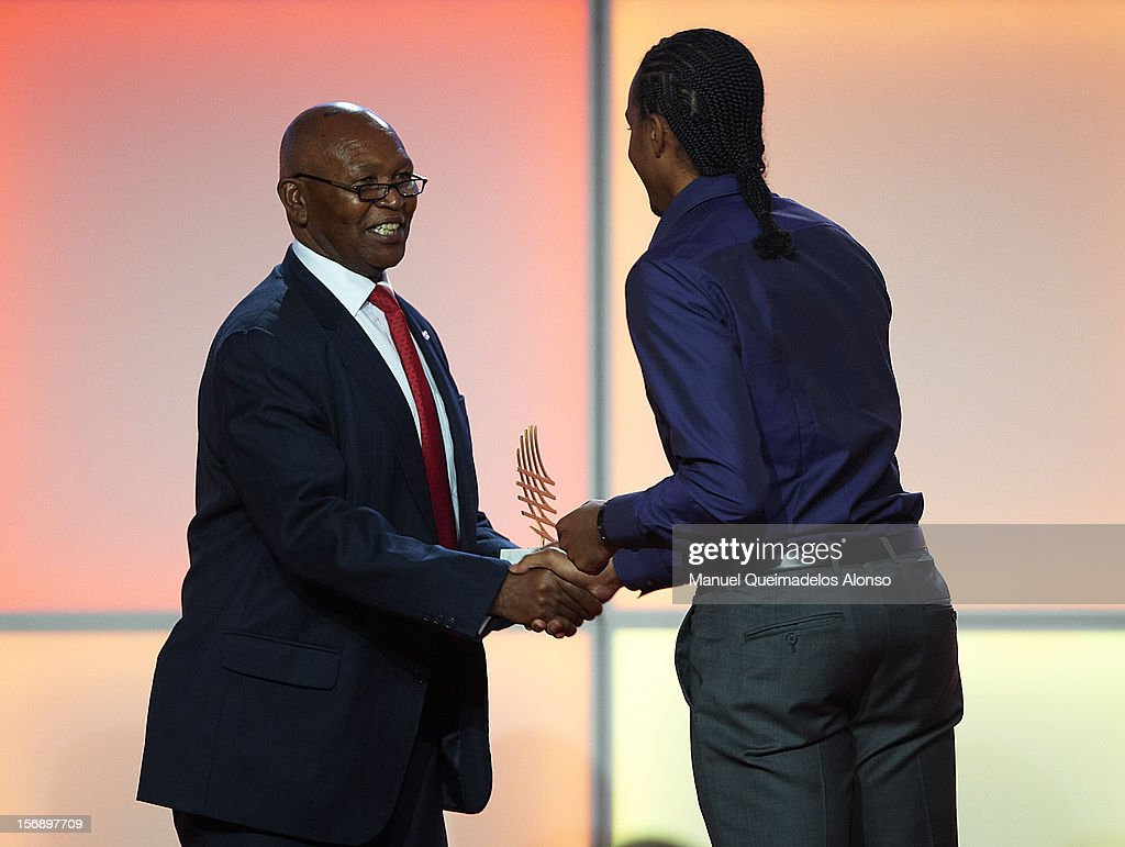 Aries Merritt (R) of United States receives the Inspirational award from Kipchoge Keino during the IAAF athlete of the year awards at the IAAF Centenary Gala on November 24, 2012 in Barcelona, Spain.