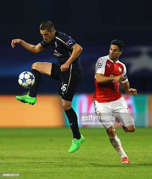 Arijan Ademi of Dinamo Zagreb is closed down by Mikel Arteta of Arsenal during the UEFA Champions League Group F match between Dinamo Zagreb and...