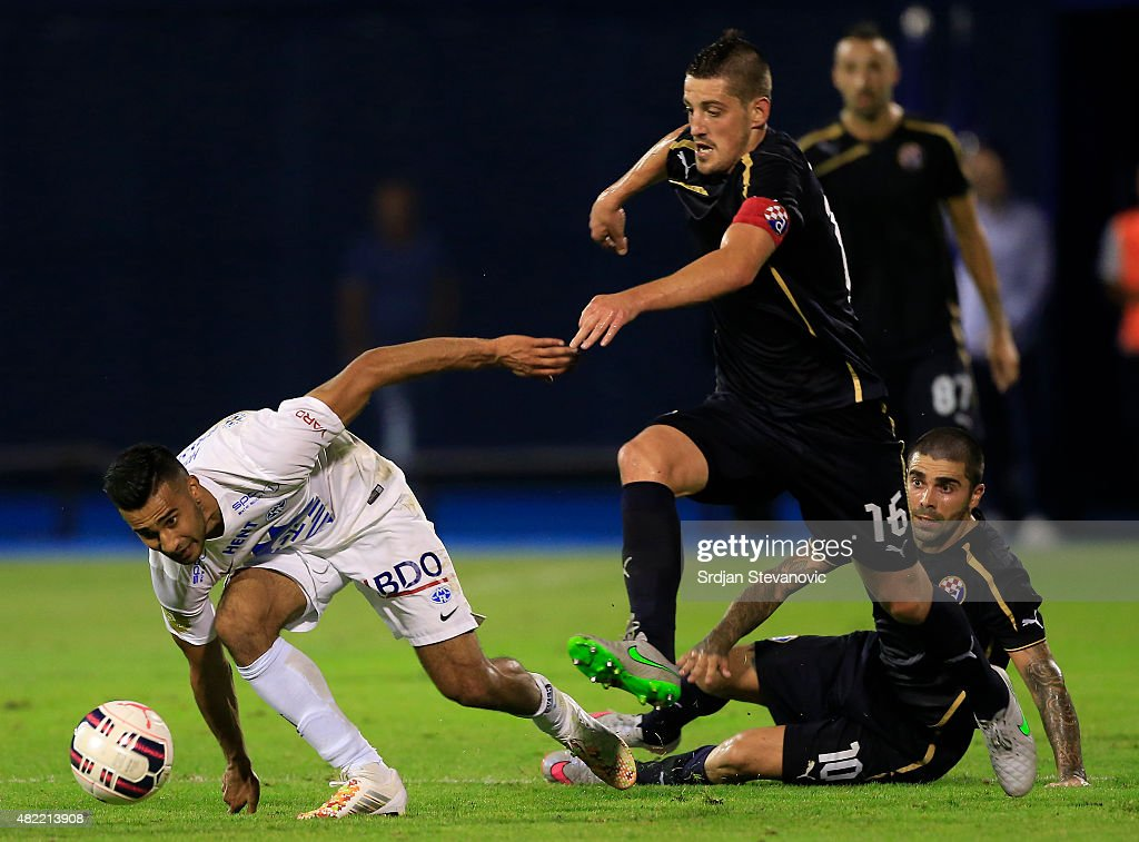 Arijan Ademi (R) of FC Dinamo Zagreb in action against Etzaz Hussain (L) of FC Molde during the UEFA Champions League Third Qualifying Round 1st Leg match between FC Dinamo Zagreb and FC Molde at Maksimir stadium on July 28, 2015 in Zagreb, Croatia.