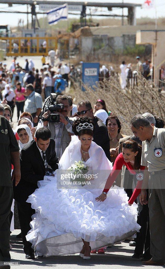 Arin Safadi a 24yearold Druze bride from Ein Qiniya in the occupied Golan Heights crosses in her wedding dress the IsraeliSyrian border into Quneitra...
