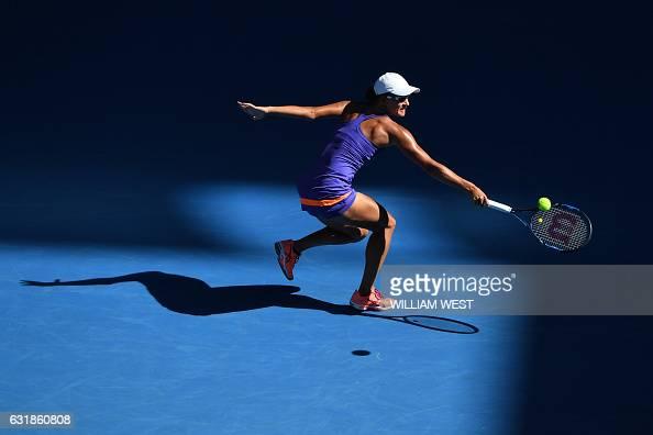 TOPSHOT Arina Rodionova of Australia hits a return against Caroline Wozniacki of Denmark in their women's singles match on day two of the Australian...