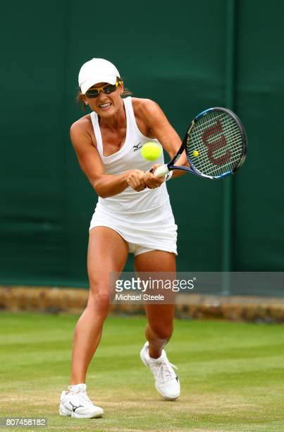 Arina Rodionova of Australia plays a backhand during the Ladies Singles first round match against Anastasia Pavlyuchenkova of Russia on day two of...