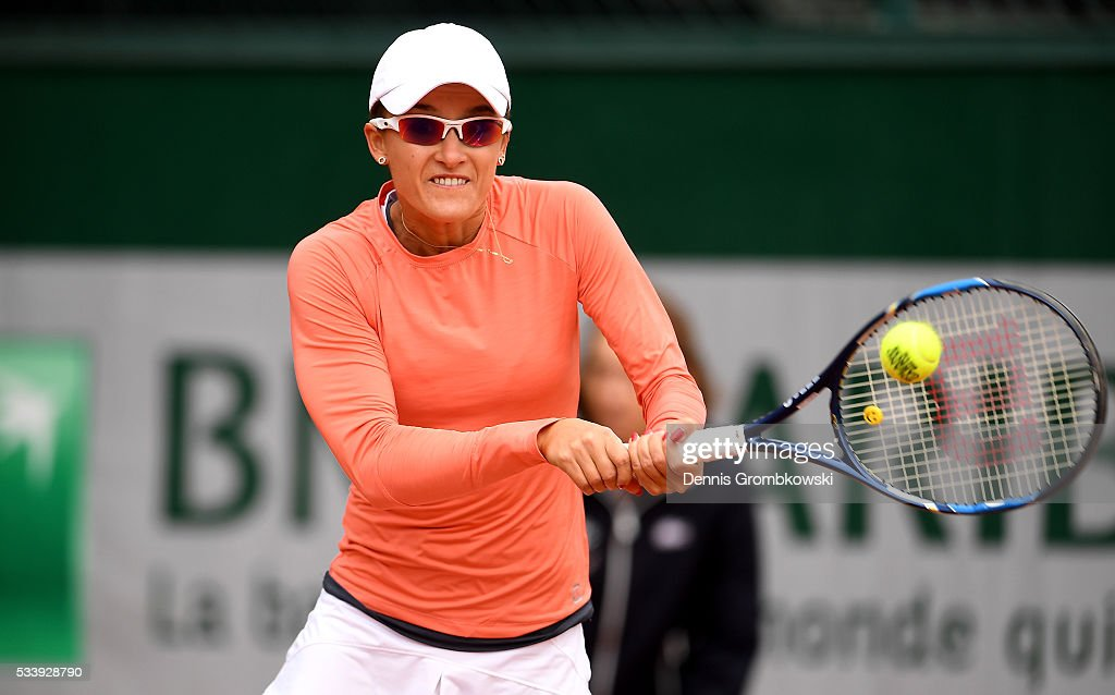 <a gi-track='captionPersonalityLinkClicked' href=/galleries/search?phrase=Arina+Rodionova&family=editorial&specificpeople=5513372 ng-click='$event.stopPropagation()'>Arina Rodionova</a> of Australia plays a backhand during the Women's Singles first round match against Ana Konjuh of Croatia on day three of the 2016 French Open at Roland Garros on May 24, 2016 in Paris, France.