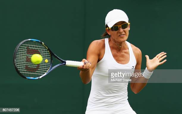 Arina Rodionova of Australia plays a forehand during the Ladies Singles first round match against Anastasia Pavlyuchenkova of Russia on day two of...