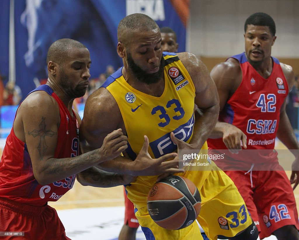 Arinze Onuaku #33 of Maccabi Fox Tel Aviv competes with Aaron Jackson #9 of CSKA Moscow during the Turkish Airlines Euroleague Basketball Regular...
