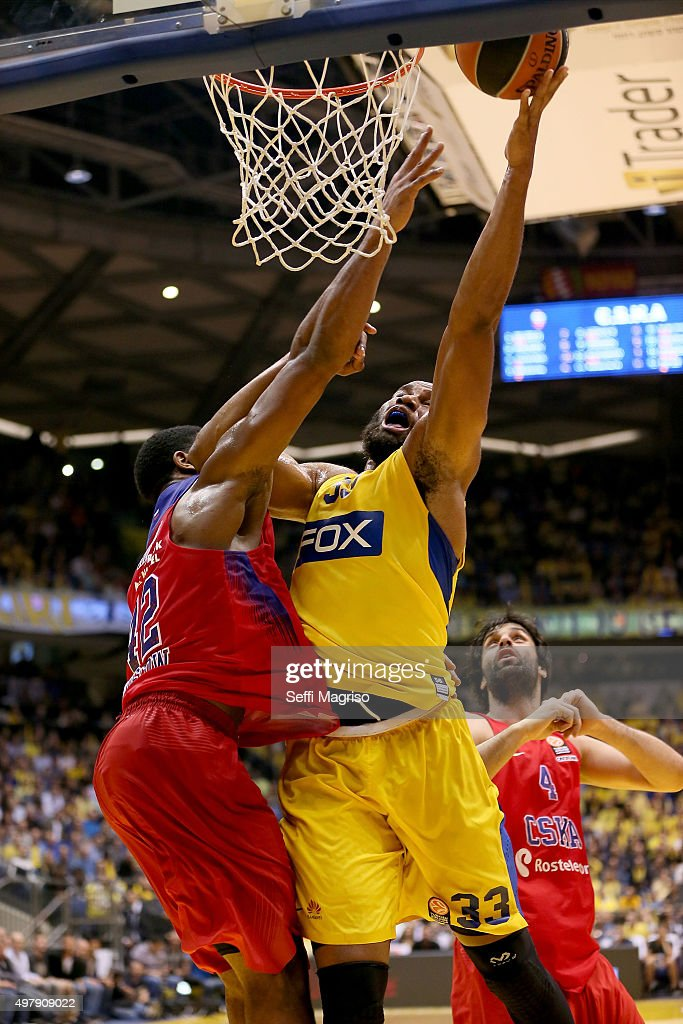 Arinze Onuaku #33 of Maccabi Fox Tel Aviv competes with Kyle Hines #42 of CSKA Moscow during the Turkish Airlines Euroleague Regular Season Round 6...