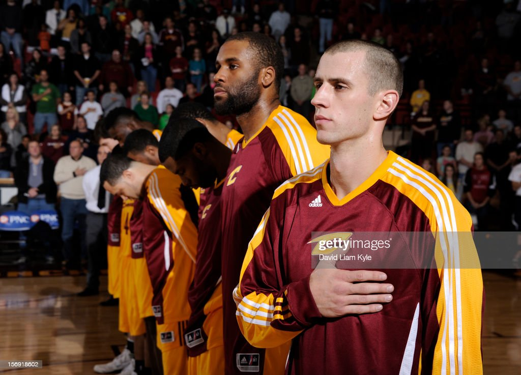 Arinze Onuaku #21 and Alex Ruoff #15 of the Canton Charge stand alongside their teammates during the National Anthem prior to the game against the Maine Red Claws at the Canton Memorial Civic Center on November 23, 2012 in Canton, Ohio.
