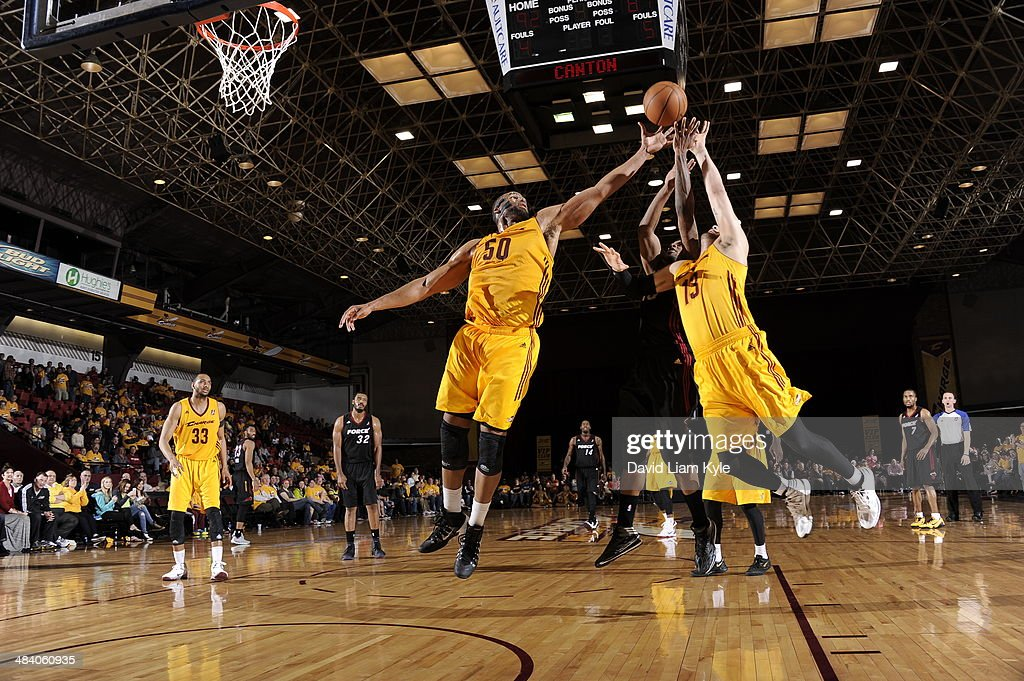 Arinze Onuaku and Antoine Agudio of the Canton Charge go up for the rebound against Larry Drew of the Sioux Falls Skyforce at the Canton Memorial...