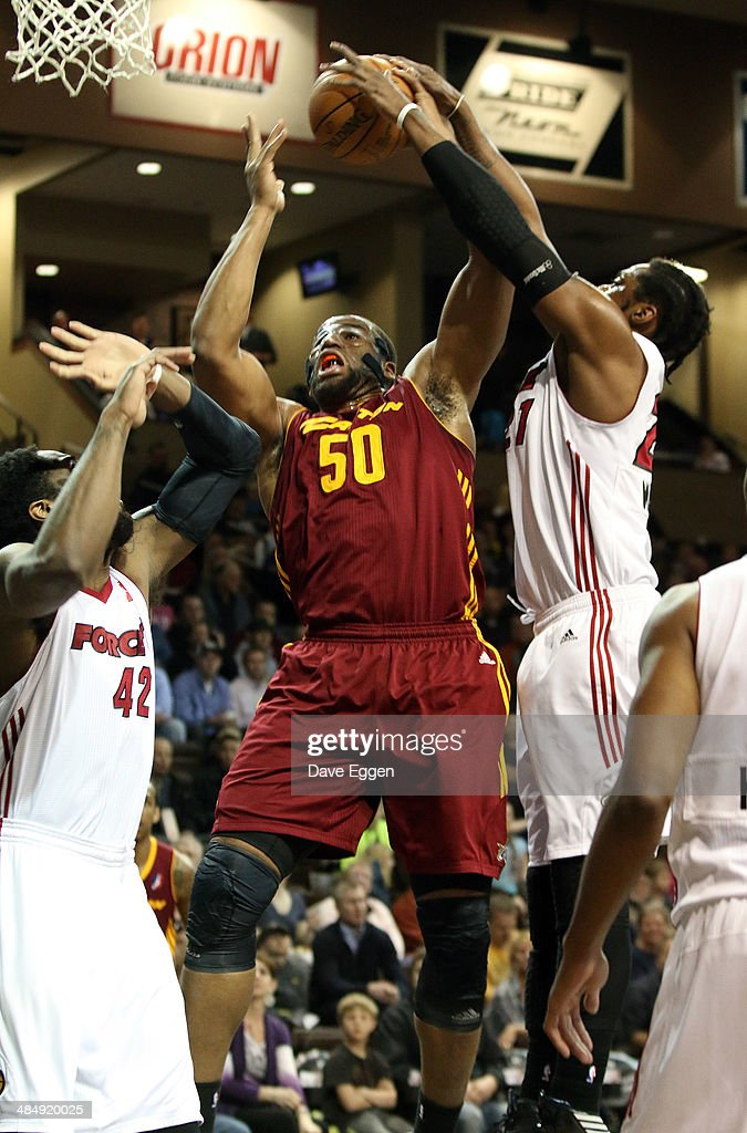 Arinze Onuaku from the Canton Charge has his shot blocked by Henry Walker from the Sioux Falls Skyforce in the first half of their NBA DLeague game...