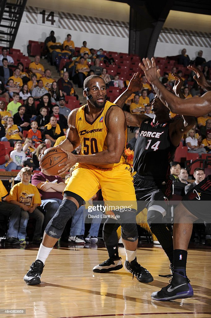 Arinze Onuaku of the Canton Charge controls the ball against DeAndre Liggins of the Sioux Falls Skyforce at the Canton Memorial Civic Center on April...