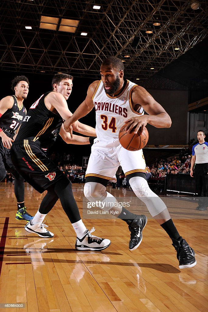 Arinze Onuaku of the Canton Charge drives to the basket against Daniel Coursey of the Erie BayHawks at the Canton Memorial Civic Center on January 31...