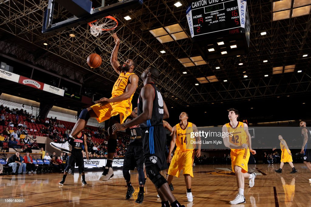 Arinze Onuaku #21 of the Canton Charge dunks the ball against Chaz Crawford #50 of the Springfield Armor at the Canton Memorial Civic Center on November 24, 2012 in Canton, Ohio.