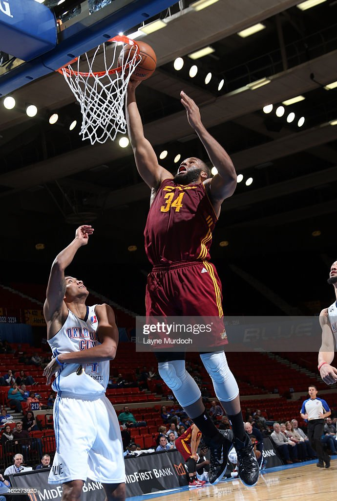 Arinze Onuaku of the Canton Charge shoots the ball against Josh Huestis of the Oklahoma City Blue during an NBA DLeague game on January 23 2015 at...
