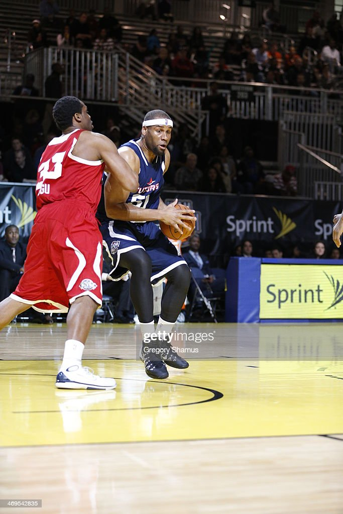 Arinze Onuaku of the Futures handles the ball against the Prospects during the NBA DLeague AllStar Game at Sprint Arena as part of 2014 NBA AllStar...