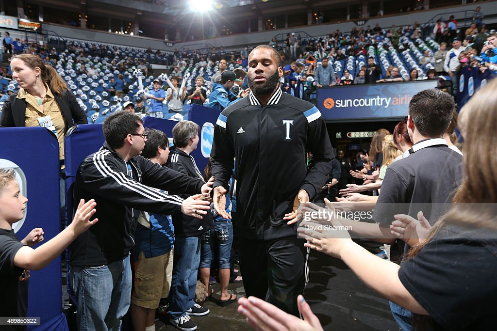 Arinze Onuaku of the Minnesota Timberwolves runs to the court before a game against the Oklahoma City Thunder on April 15 2015 at Target Center in...