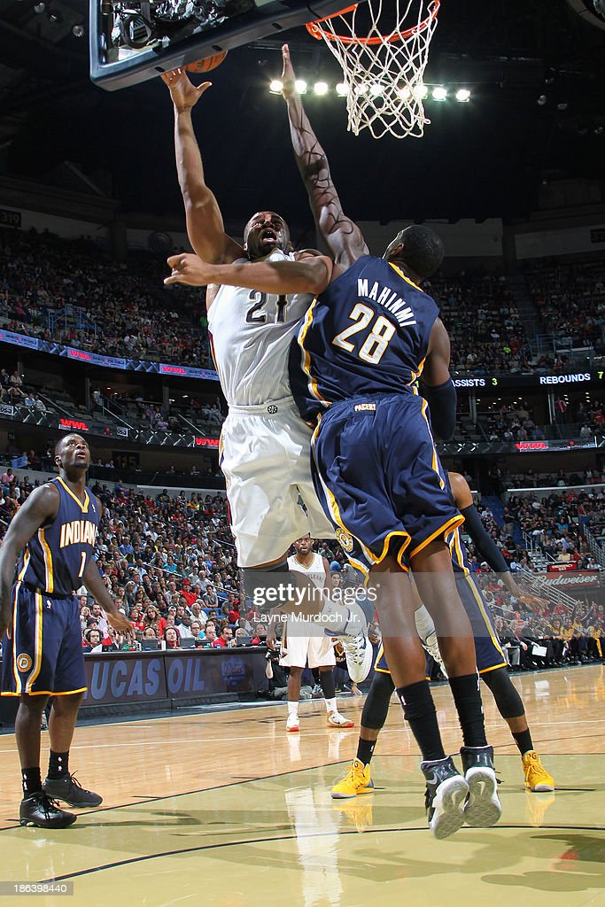 Arinze Onuaku of the New Orleans Pelicans shoots against Ian Mahinmi of the Indiana Pacers on October 30 2013 at the New Orleans Arena in New Orleans...