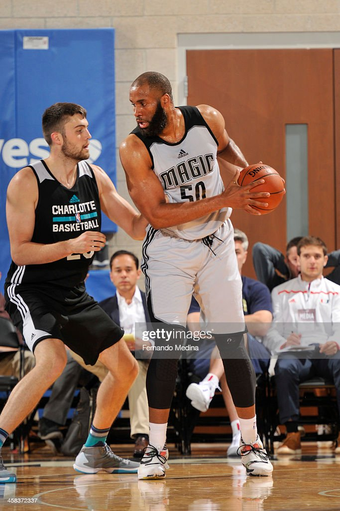 Arinze Onuaku of the Orlando Magic White defends the ball against the Charlotte Hornets during the 2016 Southwest Airlines Orlando Pro Summer League...