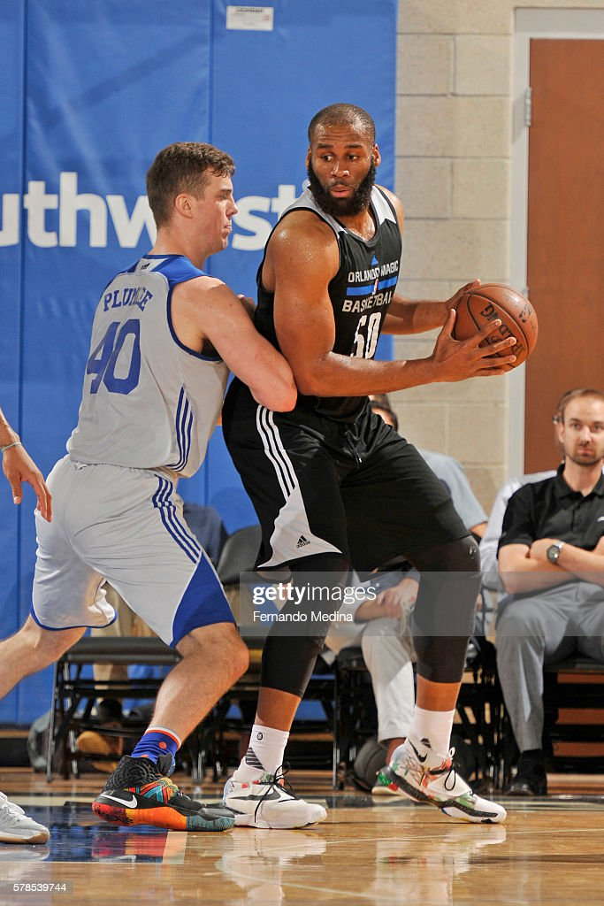 Arinze Onuaku of the Orlando Magic White posts up against the New York Knicks on July 6 2016 during the 2016 Orlando Summer League at the Amway...