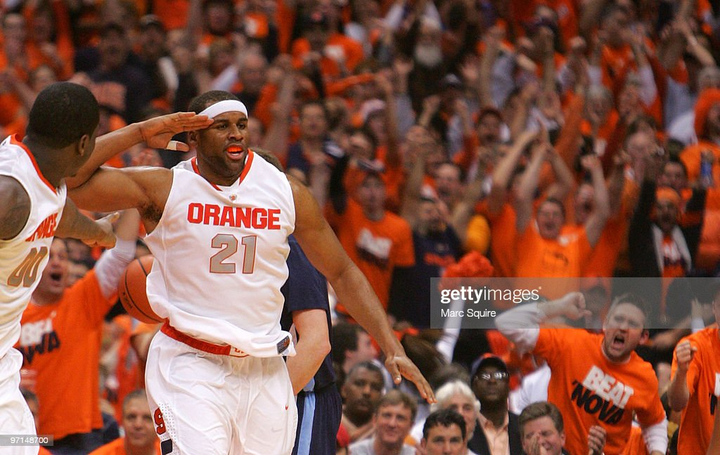 Arinze Onuaku of the Syracuse Orange salutes the crowd after a basket during the game against the Villanova Wildcats at the Carrier Dome on February...
